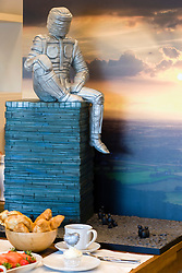 "Depicting the Yorkshire Man of steel, which will be a 35m high landmark sculpture overlooking junction 35 of the M1 and Meadowhall in South Yorkshire,  Cake Artist Rose Dummer made this impressive ""Double Death by Chocolate"" Man of Steel for the Opening of Oak Furniture Land store in Rotherham.<br />