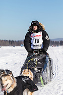 Musher Dallas Seavey competing in the 45rd Iditarod Trail Sled Dog Race on the Chena River after leaving the restart in Fairbanks in Interior Alaska.  Afternoon. Winter.
