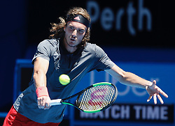 December 31, 2018 - Perth, Australia- Stefanos Tsitsipas of Greece returns the ball during the men's single match against Frances Tiafoe of the United States between the United States and Greece at Hopman Cup mixed teams tennis tournament in Perth, Australia, Dec. 31 , 2018. Stefanos Tsitsipas won 2-1. (Credit Image: © Xinhua via ZUMA Wire)