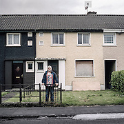 Dave Dineen outside the now derelict house in Ballyphehane, Cork, where he grew up and where he suffered neglect and physical and sexual violence by his mother and brother. He founded the group Lamh Healing Foundation in Cork to help others who have had difficult childhood experiences.