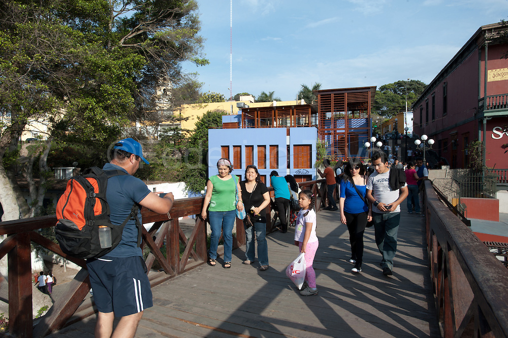 Peru, Lima, Barranco. Touists on the Puente de los Suspirios, .the most well-known tourist spot in the neighborhood.