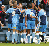 Photo: Frances Leader.<br />Wycombe Wanderers v Chester City. Coca Cola League 2.<br />01/10/2005.<br /><br />Wycombe' Tommy Mooney celebrates his gaol against Chester in the 1st half.