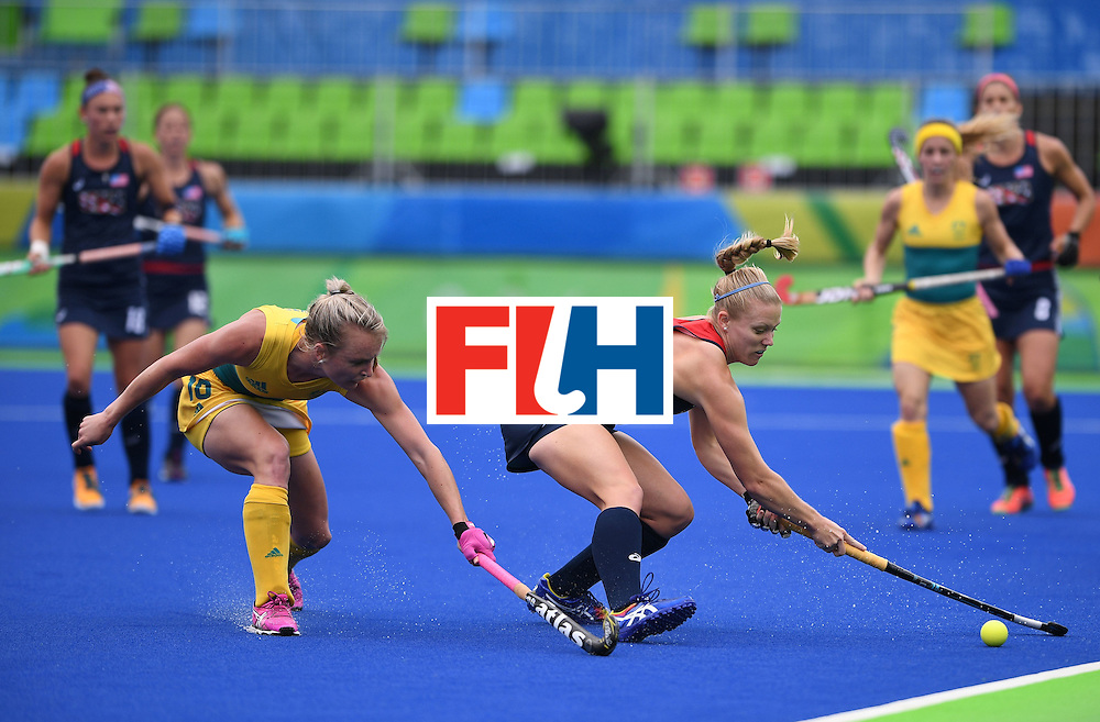 The USA's Stefanie Fee (R) stretches for the ball as Australia's Jane-Anne Claxton tries to intercept during the women's field hockey Australia vs USA match of the Rio 2016 Olympics Games at the Olympic Hockey Centre in Rio de Janeiro on August, 8 2016. / AFP / MANAN VATSYAYANA        (Photo credit should read MANAN VATSYAYANA/AFP/Getty Images)