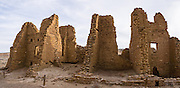 Kin Kletso Great House was built around 1120-1130 AD (based on tree-ring dates) with 65 rooms and five kivas, but was abandoned by the 1150s AD. Chaco Culture National Historical Park hosts the densest and most exceptional concentration of pueblos in the American Southwest and is a UNESCO World Heritage Site. Chaco Canyon is in remote northwestern New Mexico, between Albuquerque and Farmington, USA. From 850 AD to 1250 AD, Chaco Canyon advanced then declined as a major center of culture for the Ancient Pueblo Peoples. Chacoans quarried sandstone blocks and hauled timber from great distances, assembling fifteen major complexes that remained the largest buildings in North America until the 1800s. Climate change may have led to its abandonment, beginning with a 50-year drought starting in 1130. This panorama was stitched from 2 overlapping photos.