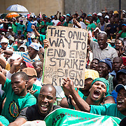 """AMCU affiliated mineworkers picketed in front of the Impala Platinum Headquarters in Johannesburg on Thursday March 27th 2014 to demand a 12,500 ZAR wage base. The Miners' strike lasted several weeks and had """"unprecented impact"""" which caused """"irreparable damages"""" according to the CEOs of the three biggest platinum producers in South Africa."""