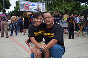 Hector Berrios, general coordinator of MUFRAS-32 and anti-mining activist, poses for a photo with his daughter during the VIII Festival for sovereignty and the People's right to self-determination in San Isidro's central park. San Isidro, Cabañas, El Salvador. September 15, 2014.