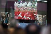 The Pope leads the Mass seen on a giant TV seen through a Monsoon shop window during Benedict XVI's papal tour of Britain 2010, the first visit by a pontiff since 1982. Taxpayers footed the £10m bill for non-religious elements, which largely angered a nation still reeling from the financial crisis. Pope Benedict XVI is the head of the biggest Christian denomination in the world, some one billion Roman Catholics, or one in six people. In Britain there are about five million Catholics but only a quarter of Catholics regularly attend Sunday Mass and some churches have closed owing to spending cuts.