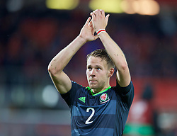 VIENNA, AUSTRIA - Thursday, October 6, 2016: Wales' Chris Gunter applauds the travelling supporters after the 2-2 draw with Austria during the 2018 FIFA World Cup Qualifying Group D match at the Ernst-Happel-Stadion. (Pic by David Rawcliffe/Propaganda)