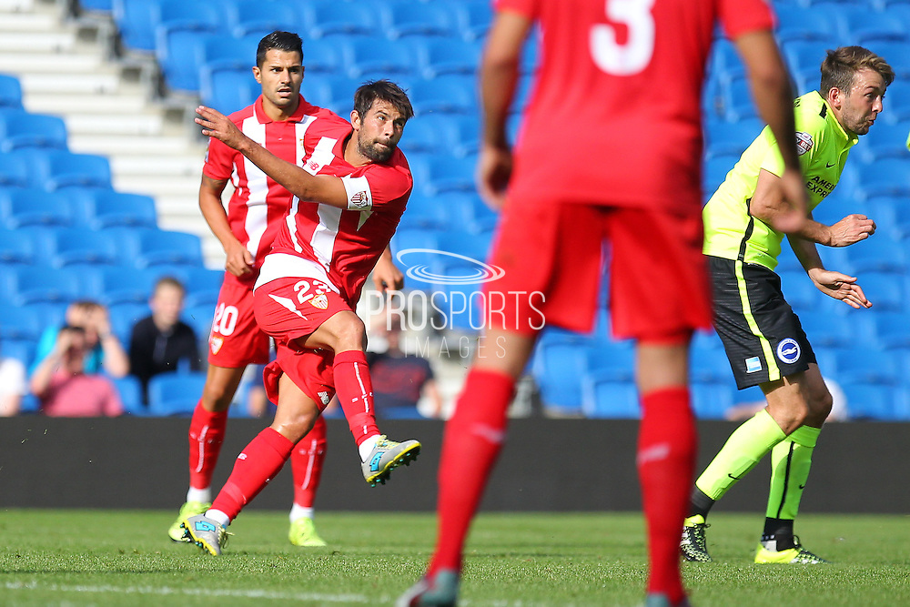 Coke of Sevilla shoots during the Pre-Season Friendly match between Brighton and Hove Albion and Sevilla at the American Express Community Stadium, Brighton and Hove, England on 2 August 2015. Photo by Phil Duncan.