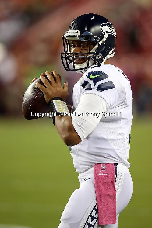 Seattle Seahawks quarterback Russell Wilson (3) smiles as he warms up before the NFL week 5 regular season football game against the Washington Redskins on Monday, Oct. 6, 2014 in Landover, Md. The Seahawks won the game 27-17. ©Paul Anthony Spinelli