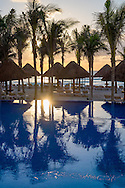 The swimming pool and beach area at sunrise at the NYX Hotel in Cancun, Mexico.