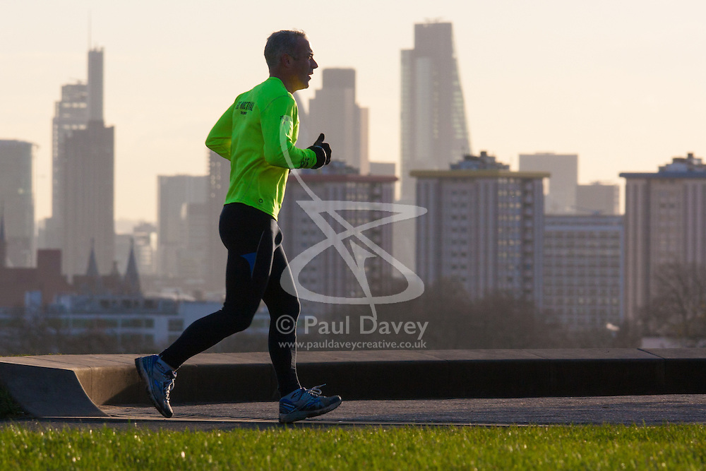 December 11th 2014. A runner makes his way over the top of Primrose Hill as sunshine greets Londoners ahead of a day of unsettled weather.