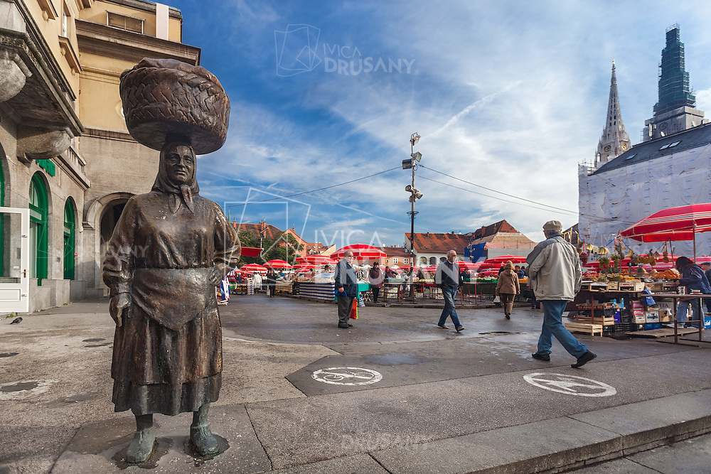 "ZAGREB, CROATIA - OCTOBER 7, 2013: ""Kumica Barica""  statue at Dolac market. Zagreb decided to pay tribute to hard working farm women, locally called ""Kumica""."