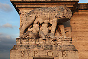 Sculpture of the Capitoline Wolf, a she-wolf suckling Romulus and Remus, founders of Rome, on the Ponte Flaminio, built 1938-51, designed by Armando Brasini, 1879-1965, in Fascist style, with columns and monumental sculptures of eagles, Corso di Francia, Rome, Italy. Fascist architecture developed in the late 1920s and 1930s, as a modernist style in times of nationalism and totalitarianism under Benito Mussolini. It is characterised by large, square, symmetrical buildings with little or no decoration, often inspired by ancient Rome and designed to convey strength and power. Picture by Manuel Cohen