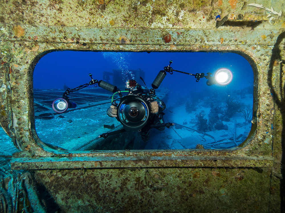 Underwater photographer and cameraman Cristian Dimitrius in action at a shipwreck near Nassau, Bahamas