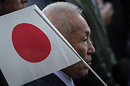 An well-wisher holds a Japanese national flag as Japan's Emperor Akihito (not pictured) appears on a balcony of the Imperial Palace to celebrate his 84th birthday in Tokyo, Japan, December 23, 2017. 23/12/2017-Tokyo, JAPAN