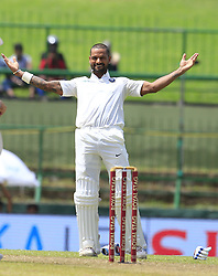 August 12, 2017 - Colombo, Sri Lanka - Indian cricketer Shikhar Dhawan celebrates after scoring 100 runs during the 1st Day's play in the 3rd Test match between Sri Lanka and India at the Pallekele International cricket stadium, Kandy, Sri Lanka on Saturday 12 August 2017. (Credit Image: © Tharaka Basnayaka/NurPhoto via ZUMA Press)