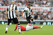 Brighton & Hove Albion's central midfielder Beram Kayal (7) fouls Newcastle United midfielder Ayoze Perez (17) during the EFL Sky Bet Championship match between Newcastle United and Brighton and Hove Albion at St. James's Park, Newcastle, England on 27 August 2016.