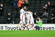 MK Dons players celebrate Joe Walsh's goal during the Sky Bet Championship match between Milton Keynes Dons and Reading at stadium:mk, Milton Keynes, England on 16 January 2016. Photo by Dennis Goodwin.