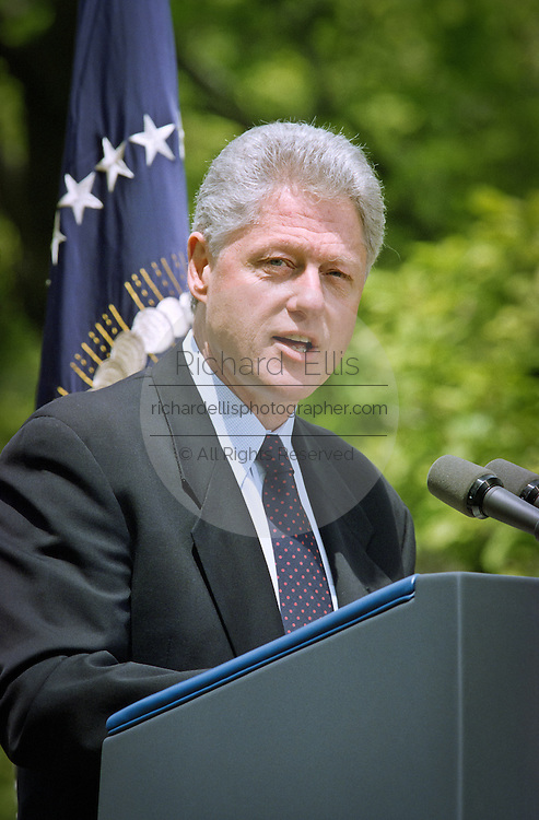 President Bill Clinton addresses reporters behind the Oval Office about his discussions with Congressional leaders on the Kosovo situation April 28, 1999. The president reaffirmed his commitment to support NATO military actions in coming months.