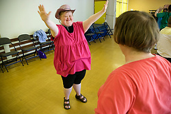 Day Service users with learning disability taking part in dance class,