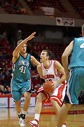 18 November 2007: Levi Dyer drives the lane closely guarded by Todd Hendley.  Illinois State Redbirds defeated the Seahawks of the University of North Carolina - Wilmington 89-73 on Doug Collins Court in Redbird Arena on the campus of Illinois State University in Normal Illinois.