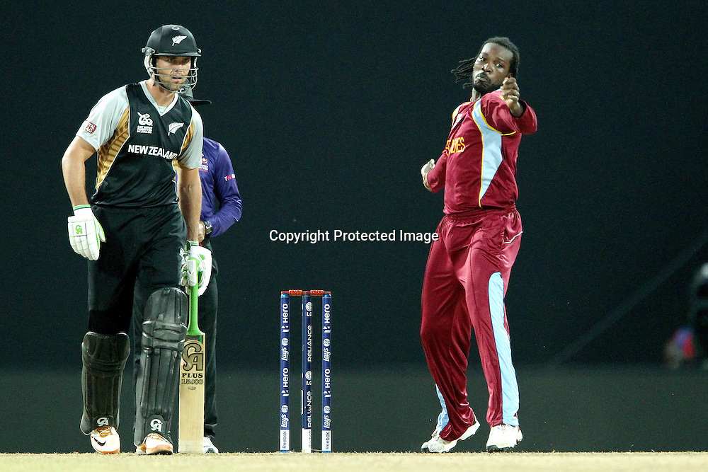 Chris Gayle of The West Indies bowls during the ICC World Twenty20 Super Eights match between The West Indies and New Zealand held at the  Pallekele Stadium in Kandy, Sri Lanka on the 1st October 2012<br /> <br /> Photo by Ron Gaunt/SPORTZPICS/PHOTOSPORT