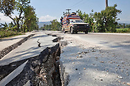 Vehicals avoiding cracks on Route 3 in Leogane, where the epicenter of the earthquake hit Haiti on January 12, 2010 .The  damaged  to the road connecting Porto-au-Prince and Jacmel illustrates the strengh of the maginitude 7.0 earthquake.