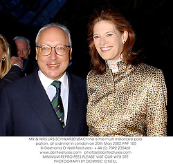 MR & MRS URS SCHWARZENBACH he is the multi millionaire polo patron, at a dinner in London on 20th May 2002.PAF 105