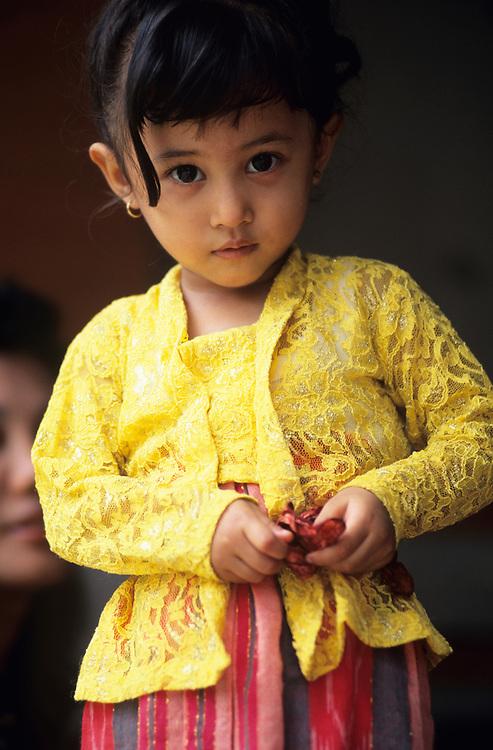 Bali, Ubud, Balinese girl child at palace
