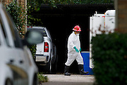 A haz-mat crew prepares to clean the apartment where a second Ebola patient has been reported in Dallas, Texas on October 13, 2014. (Cooper Neill for The New York Times)