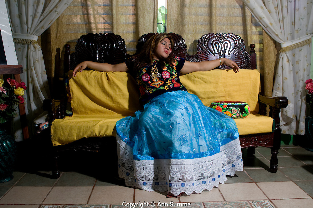 "Juchitan, Mexico:   ""La Luz de la Luna,"" Biani Bew Marcelino, or Marci, is a muxe, or transvestite, living in the Oaxacan town of Juchitan. Here she dresses in her aunt's traditional, richly embroidered, Tejuana huipil and modernized skirt.  Muxes are very common, and accepted, in this Southern Oaxacan region, which claims to not discriminate against gays. The matriarchal society is still driven by women but in flux in the machismo culture of Mexico. Sept 15, 2008. (photo: Ann Summa)."