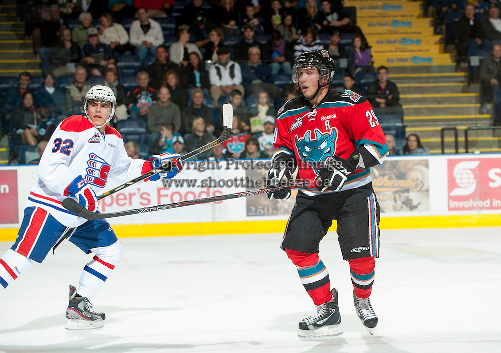 KELOWNA, CANADA - OCTOBER 10:  Myles Bell #29 of the Kelowna Rockets skates on the ice with Todd Fiddler #32 of the Spokane Chiefs at the Kelowna Rockets on October 10, 2012 at Prospera Place in Kelowna, British Columbia, Canada (Photo by Marissa Baecker/Shoot the Breeze) *** Local Caption ***