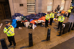 © Licensed to London News Pictures. 07/10/2019. London, UK. Police confiscate equipment from an Extinction Rebellion protest on Lambeth Bridge . Photo credit: George Cracknell Wright/LNP