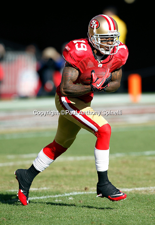 San Francisco 49ers kick returner Ted Ginn Jr. (19) returns a second quarter kickoff to the 39 yard line during the NFL week 11 football game against the Tampa Bay Buccaneers on Sunday, November 21, 2010 in San Francisco, California. The Bucs won the game 21-0. (©Paul Anthony Spinelli)