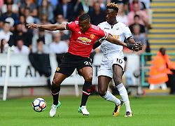 Tammy Abraham of Swansea City battles for the ball with Luis Antonio Valencia of Manchester United - Mandatory by-line: Alex James/JMP - 19/08/2017 - FOOTBALL - Liberty Stadium - Swansea, England - Swansea City v Manchester United - Premier League