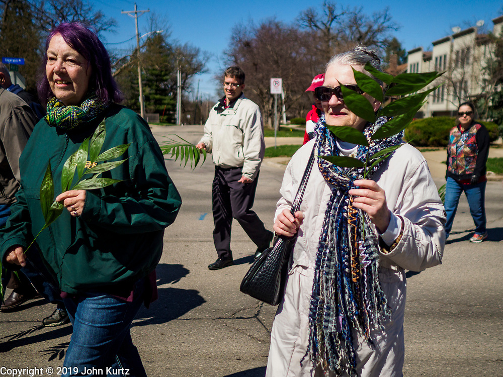 """14 APRIL 2019 - DES MOINES, IOWA: People participate in the Palm Sunday procession for peace in Des Moines. About 200 people participated in an interdenominational  Palm Sunday procession calling for peace. The theme of the procession was """"To Love and Defend our Sacred Earth"""", it was sponsored by Des Moines Faith Committee for Peace.    PHOTO BY JACK KURTZ"""