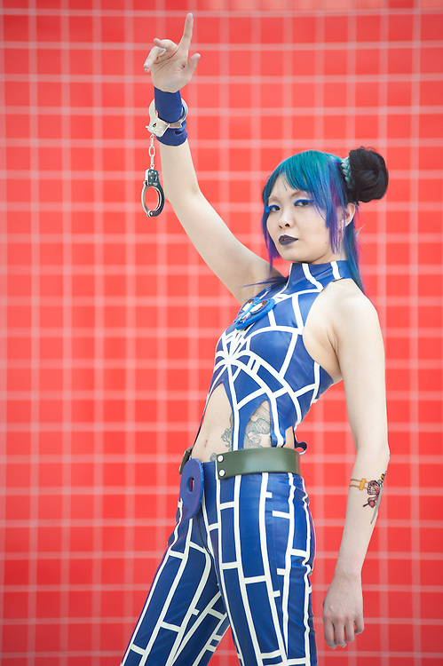 London, UK - 26 May 2013: I-Ching Logan dressed as Kujo Jolyne from Jojo's Bizarre Adventure poses for a picture during the London Comic Con 2013 at Excel London. London Comic Con is the UK's largest event dedicated to pop culture attracting thousands of artists, celebrities and fans of comic books, animes and movie memorabilia.