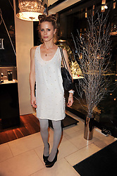 LAURA BAILEY at a party for TACH jewellery held at Tach, 13 Grafton Street, London on 10th December 2009.