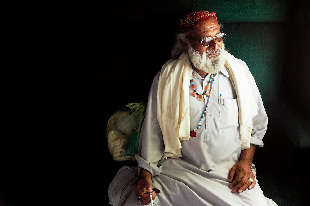 Syed Farid Haider, 70 years old sits on the Khyber Mail traveling from Karachi to Peshawar on August 19, 2011. From Khan Pur, he has a child.