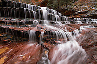 Archangel Falls lie along the trail to The Subway in Zion National Park and provide a scenic view of cascading water over sandstone.