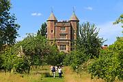 Red brick tower and blue sky Sissinghurst castle gardens, Kent, England, UK