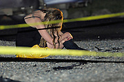 Peachland, BC- 02/06/10 -  A partygoer grieves as she waits to be interviewed by police after 16-year-old Ashlee Hyatt was stabbed and killed at the party. Photo by Daniel Hayduk