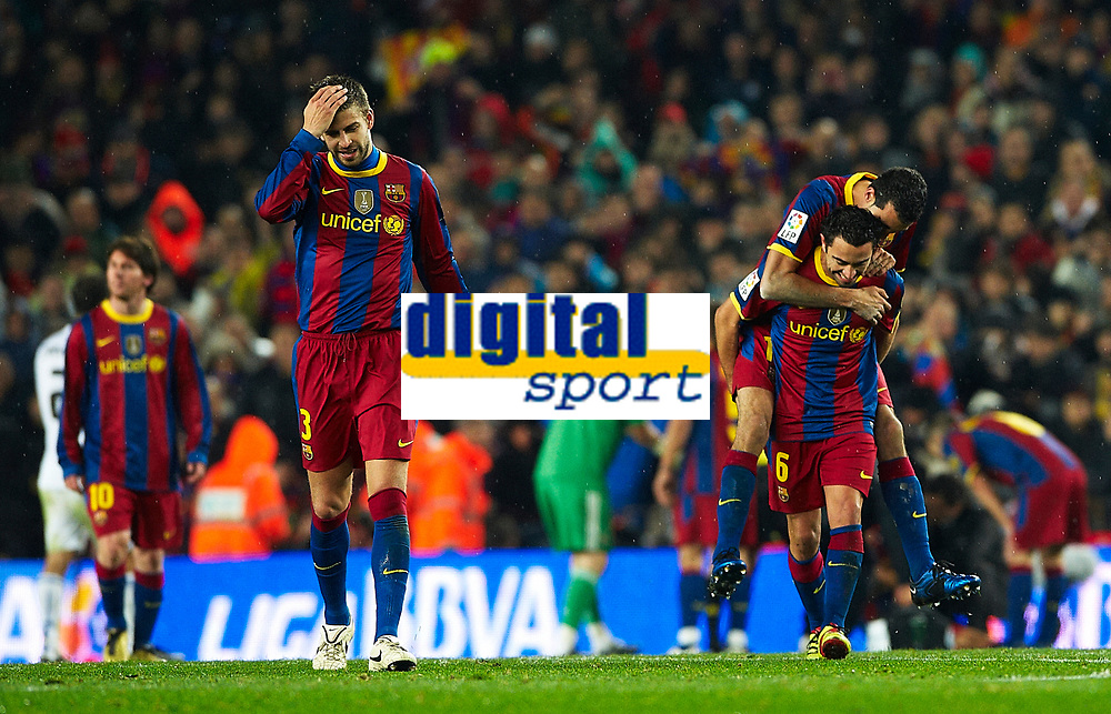 BARCELONA, SPAIN - NOVEMBER 29: Joy Xavi Hernandez of Barcelona celebrates his goal during the La Liga match between Barcelona and Real Madrid at the Camp Nou Stadium on November 29, 2010 in Barcelona, Spain. (Photo by Manuel Queimadelos/DPPI)