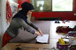 August 29, 2017 - Gaza, gaza strip, Palestine - A Palestinian fashion designer working in her shop in Gaza City on August 29, 2017. (Credit Image: © Majdi Fathi/NurPhoto via ZUMA Press)