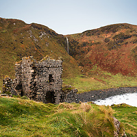 Remnants of the Kinbane Castle sit on a lush and rugged Northern Ireland landscape. Besieged by canon fire in 1555, then rebuilt, it continued to see battles, bloodshed and exchanges of ownerships. Now it's rather small yet mysterious remains are a Scheduled Historic Monument. County Antrim Northern Ireland. 2016