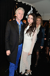PHILIP TREACY and ALFREDA MAXWELL at the Warner Music Group & Belvedere BRIT Awards After Party held at The Savoy, London on 19th February 2014.