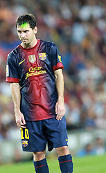 Lionel Messi is targeted by a fan wielding a laser gun as he attempts to distract the Barca player from scoring from a free kick. Barcelona v Real Madrid, Supercopa first leg, Camp Nou, Barcelona, 23rd August 2012...Credit - Eoin Mundow/Cleva Media.