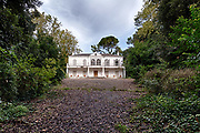 """The haunting images of a once-glamorous Italian villa that now lies abandoned <br /><br />These haunting images, by 37-year-old Dutch photographer Maikel Brands, reveal how the villa's glamorous days are long over, because the building, in the Marche region, lies abandoned, with nature reclaiming the pool and the insides looking more spooky than spectacular.<br /><br />Maikel Brands said: """"Too bad the swimming pool was empty, because a little pool party would be nice. Once inside I was stunned by its beauty. Such a lovely staircase, so much detail. But when I entered the master bedroom I couldn't believe my eyes. How is it possible that such a beautiful place is abandoned""""<br />©Maikel Brands/Exclusivepix Media"""