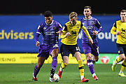 Shrewsbury Town midfielder Josh Laurent (28) battles for possession  with Oxford United midfielder Mark Sykes (18) during the EFL Sky Bet League 1 match between Oxford United and Shrewsbury Town at the Kassam Stadium, Oxford, England on 7 December 2019.